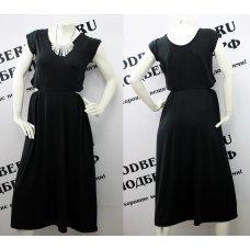 Необычное длинное черное платье